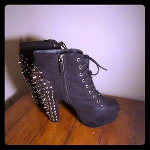 Slightly worn spiked booties